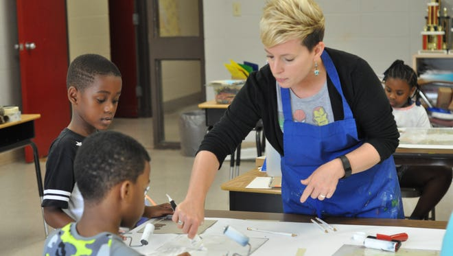 Cindy Blair, an educator at the Alexandria Museum of Art, teaches art to kids during Camp Carter, an enrichment program for students at Carter C. Raymond Elementary School.