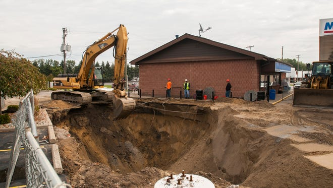 Work continues at the Marathon gas station at Holland and Pine Grove Avenue Monday, Oct. 17, in Port Huron.