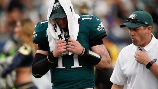 Philadelphia Eagles quarterback Carson Wentz leaves the field during the second half of an NFL football game against the Los Angeles Rams Sunday, Dec. 10, 2017, in Los Angeles.(AP Photo/Kelvin Kuo) ORG XMIT: OTKCC30435