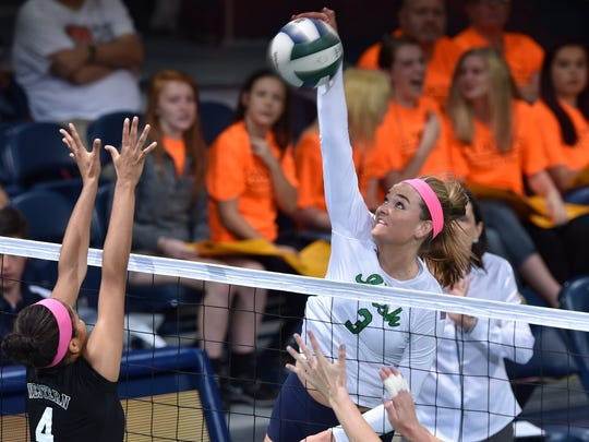 Ursuline alumna Sam Fry, shown as a freshman at Notre Dame, spikes the ball during a match against Western Michigan.