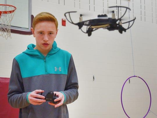 Eighth grader Garret Boll flies a drone at the Roosevelt