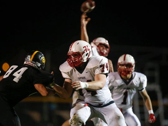 Creston junior offensive lineman Trevor Downing makes his presence known against Winterset at Winterset High School on Friday, Sept. 30, 2016.