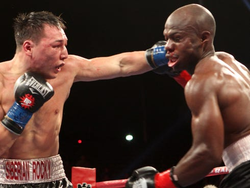 Ruslan Provodnikov, leftr, lands a left to the head of Timothy Bradley Jr. during the 12th round of their  WBO Welterweight Championship fight in March. Bradley barely made it through the 12th and won the fight