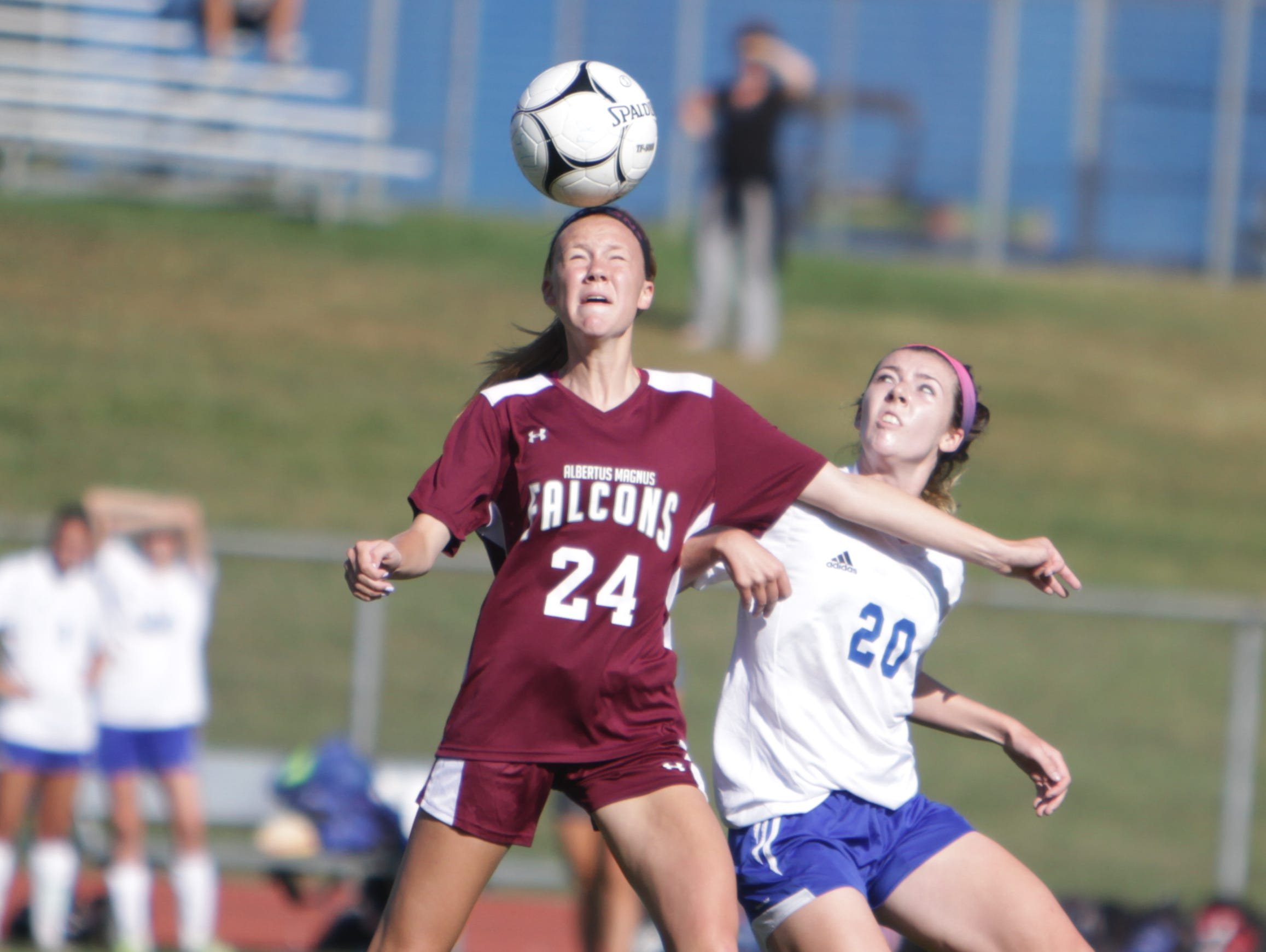 Albertus Magnus' Mazie Stiles (24) wins an aerial battle for the ball against Pearl River's Cate Feerick during a Section 1 girls soccer game between Pearl River and Albertus Magnus at Pearl River High School on Saturday, Sept. 17th, 2016. The teams played to a scoreless draw.