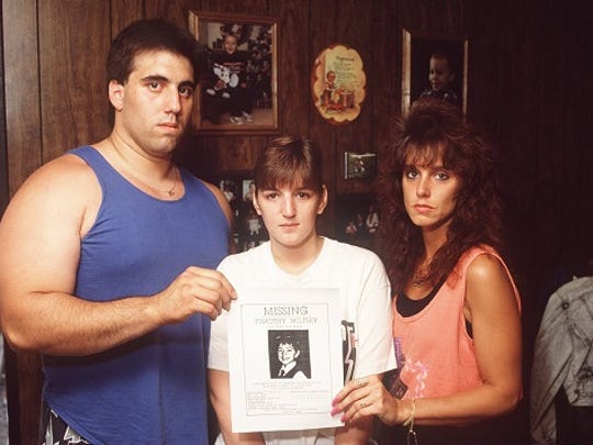 Frank Bruno, Michelle Lodzinski and Cheryl Kassay with a missing poster of Timothy Wiltsey on May 29, 1991, less than a week after Lodzinski reported her son missing from a  carnival in Sayreville.