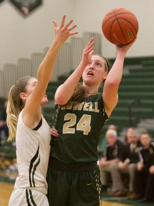 Leah Weslock of Howell makes this shot and is fouled by Novi's Mikayla Lynch in the third quarter of the game at Novi Tuesday, Jan. 23, 2018.
