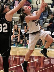 Tularosa's Shacie Marr, right, attempts a layup.