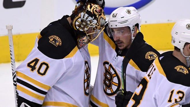 Bruins forward Brad Marchand, center, came to the defense of goalie Tuukka Rask on Wednesday.