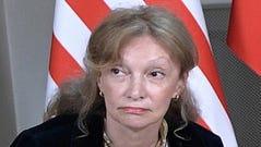 US interpreter Marina Gross looks on during a meeting