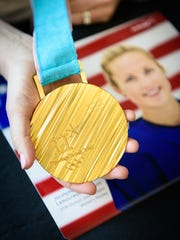 Team USA women's hockey player Jocelyne Lamoureux-Davidson shares her Olympic gold medal with Arthrex employees at the company's manufacturing facility on Thursday, May 3, 2018, in Ave Maria, Fla. Lamoureux-Davidson, who scored the game-winning shootout goal for Team USA at the 2018 Winter Olympics, had a shoulder repair with Arthrex products in 2014.  (Photo courtesy of Arthrex)