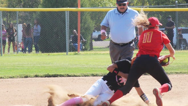 La Junta High School's Hunter Wallace successfully steal second base before Rocky Ford's Sidney Larrew can apply the tag Saturday at Tippy Martinez Park. The Lady Meloneers defeated the Lady Tigers 4-2.