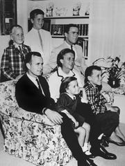 In this 1964 file photo, George H.W. Bush sits on couch