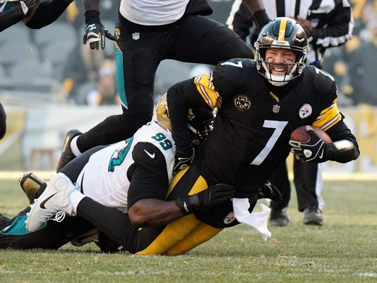 Pittsburgh Steelers quarterback Ben Roethlisberger (7) is brought down by Jacksonville Jaguars defensive tackle Marcell Dareus (99) during the first half of an NFL divisional football AFC playoff game in Pittsburgh, Sunday, Jan. 14, 2018. (AP Photo/Don Wright)