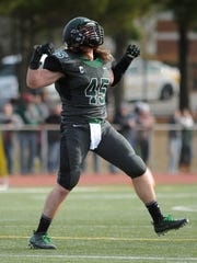 West Deptford's Kyle Garrison reacts after making a tackle against Cedar Creek during Sunday's  South Jersey Group 2 championship game at Rowan University.