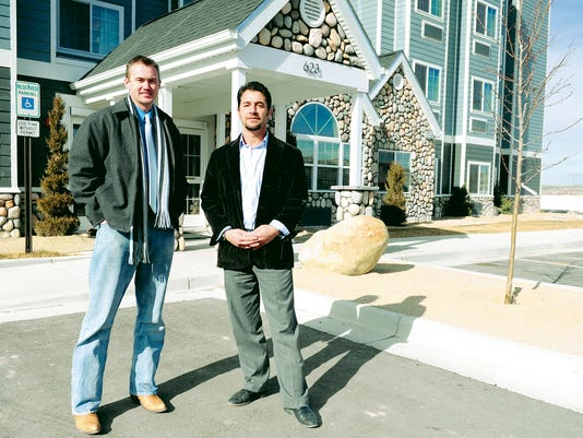 Aztec City Manager Joshua Ray, left, stands in front of the Aztec Microtel Inn & Suites by Wyndham on Thursday with Sam Blue, president of Ace Development and owner of Dillon Industrial Park, where the hotel is located.