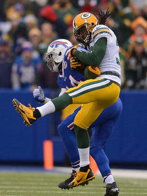 Green Bay Packers cornerback Tramon Williams makes an interception against the Buffalo Bills receiver Sammy Watkins (14) in the second quarter during Sunday's game at Ralph Wilson Stadium in Orchard Park, New York. Evan Siegle/P-G Media