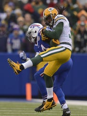 Green Bay Packers cornerback Tramon Williams makes an interception against the Buffalo Bills receiver Sammy Watkins (14) in the second quarter during Sunday's game at Ralph Wilson Stadium in Orchard Park, N.Y.