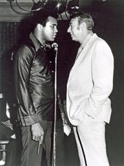 Muhammad Ali and Howard Cosell in 1975.