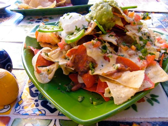 An order of nachos is a meal in itself at Calico Jack's