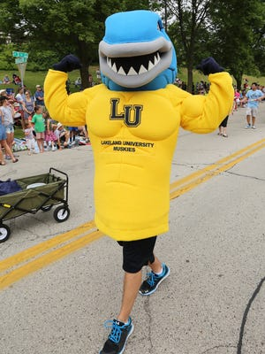Lakeland University shows off its new name during the Fourth of July parade Monday July 4, 2016 in Sheboygan.
