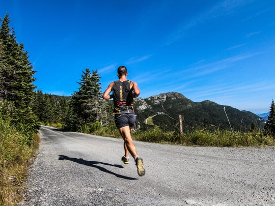 Eric Blake, winner of the 2013 North Face Race To The Top Of Vermont, runs the scenic Toll Road.