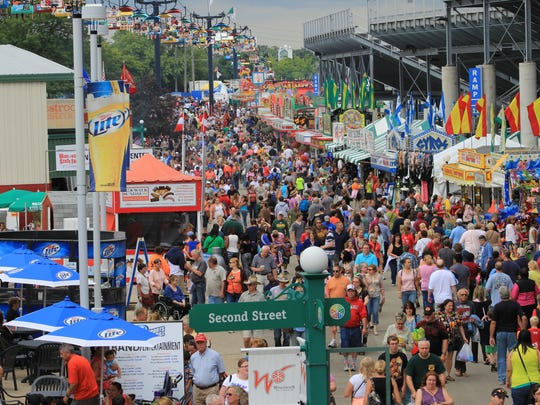 It's food and folks for as far as the eye can see on Grandstand Avenue.