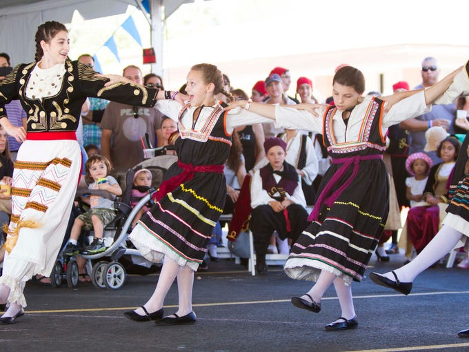The Eliopoula dance group takes the stage during the Taste of Greece Festival at St. Katherine's Greek Orthodox Church, Sunday, October 5, 2014, in Chandler, Ariz.
