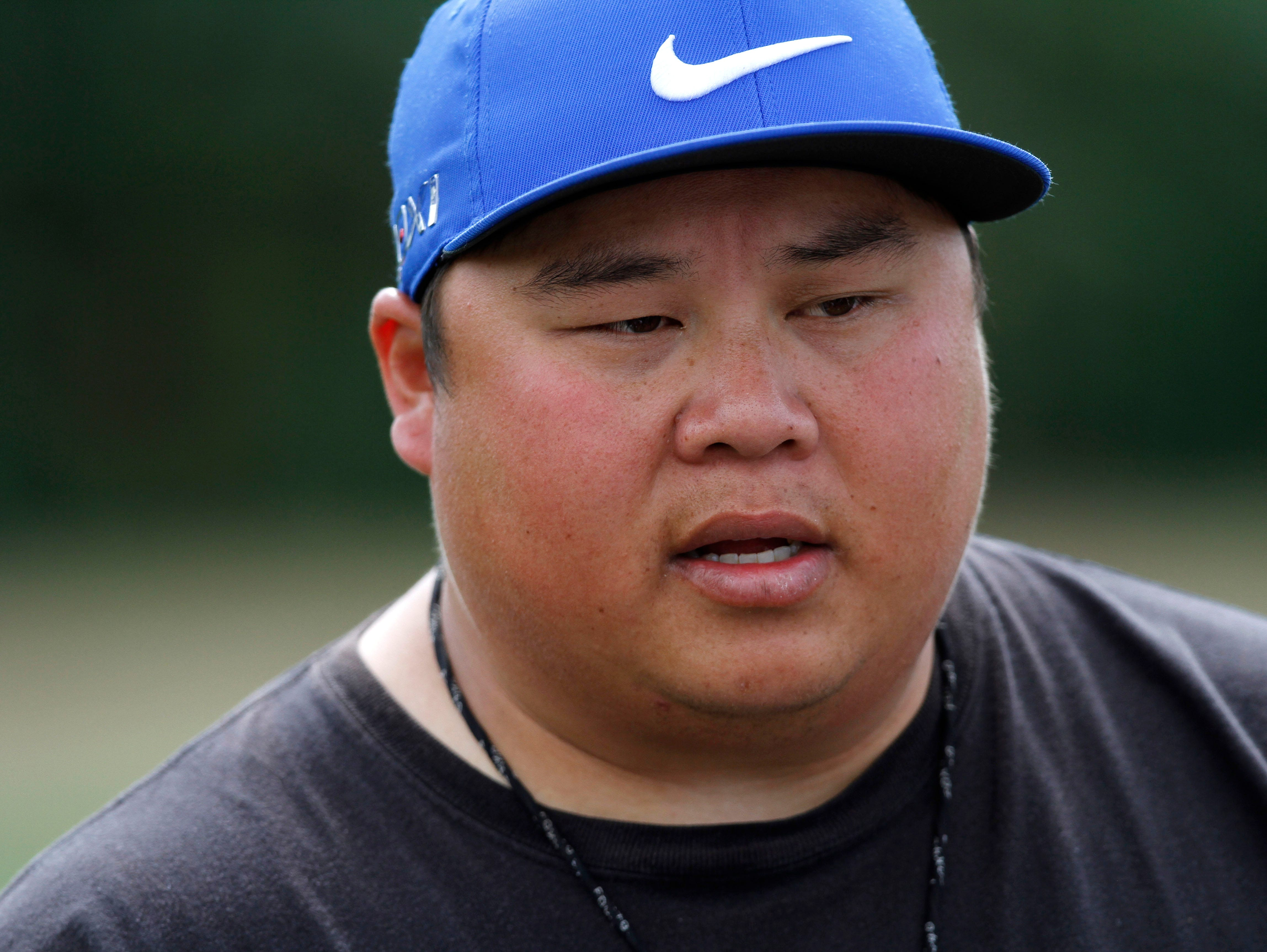 McNary High School football coach Isaac Parker talks wit the team after practice on Wednesday, Aug. 20, 2014, in Keizer, Ore.