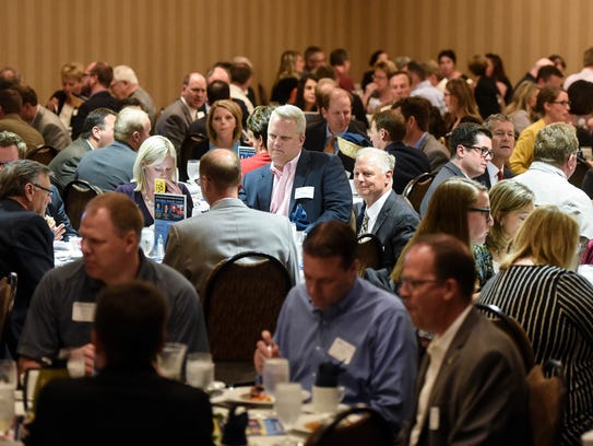 Attendees share conversation during the annual St.
