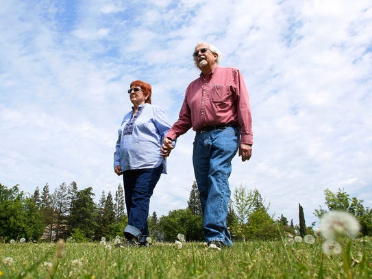 John Taylor and his wife, Judith Eymann-Taylor, are photographed in a park on Tuesday, April 10, 2018, in Fresno, Calif. They are having difficulty breathing in the polluted air of the San Joaquin Valley to the point that they have to pack up and move to another city.