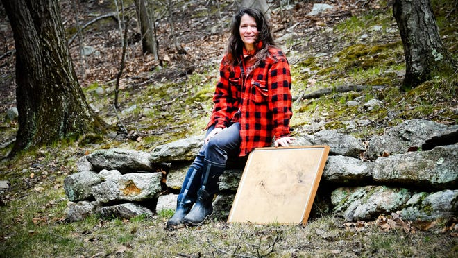 "Amy Kupferberg outside of her Warwick studio, with one of her ""mark making"" pieces of art. In 2010, Kupferberg moved to Warwick to be closer to nature."