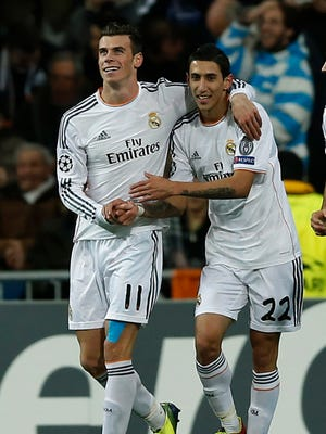 Real's Gareth Bale, left, and Angel Di Maria each scored to help Real Madrid beat Galatasaray.
