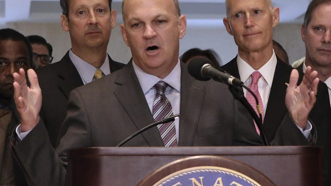 House Speaker Richard Corcoran, R-Land O'Lakes, center, addresses legislators and media at the end of the special session Friday as Senate President Joe Negron, R-Stuart, left, and Gov. Rick Scott look on.