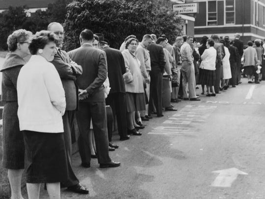 In a April 5, 1961 photograph, people wait in line
