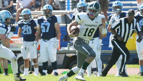 Pleasantville quarterback Jack Howe (18) runs for his