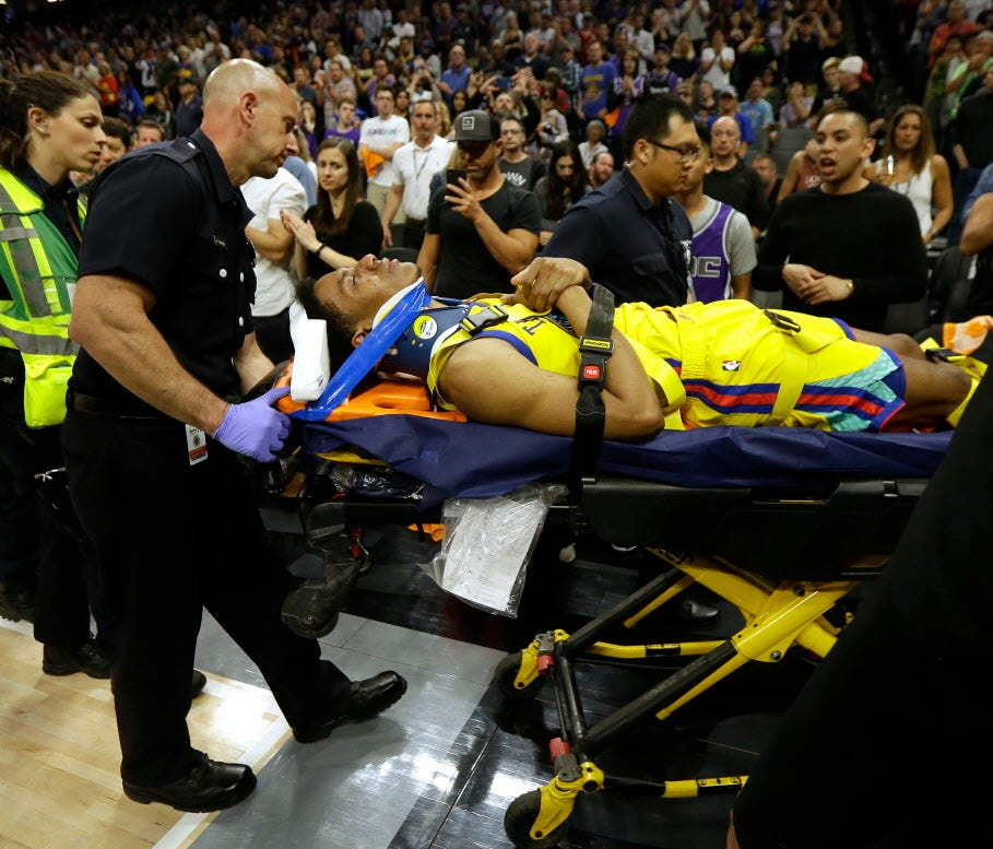 Warriors guard Patrick McCaw is taken off the court on a stretcher after falling hard to the floor late in the third quarter against the Kings in Sacramento.