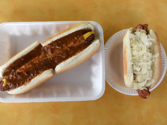 A jumbo dog and a regular dog with kraut at Johnny & Hanges.