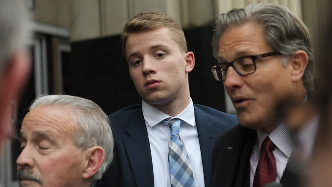 Thomas Kithier, center, behind his family's attorneys Ven Johnson, right, and Steve Fishman, left, outside the Federal Courthouse in Detroit last month.