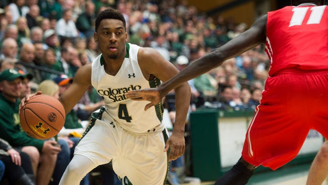 Guard John Gillon, who is transferring from CSU for his final season, drives against a New Mexico defender during a Feb. 23 game at Moby Arena. Gillon said he already has received offers from about 20 schools, all in Power 5 conferences, including 2016 Final Four teams Oklahoma and Syracuse.
