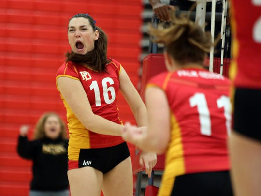 Palm Desert's Taylor Harvey celebrates a point during the first-round playoff game against Roosevelt in Palm Desert on Tuesday, November 1, 2016.