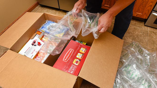 Contents in the box are packed well with bubble wrap on the cookies and chips in a Target Restock home deliver package shown Friday, June 30, in St. Cloud.