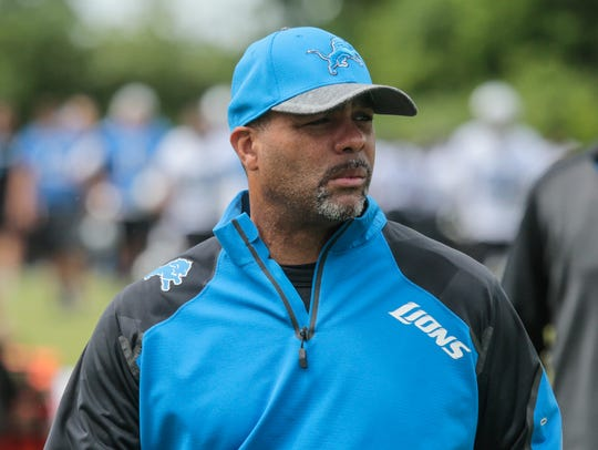 Lions defensive coordinator Teryl Austin walks off