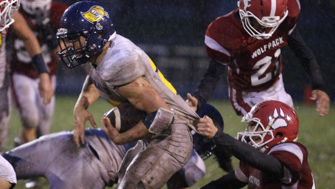Pewamo-Westphalia's Jared Smith, left, is among the Lansing area participants in the Michigan High School Football Coaches Association East-West All-Star game.