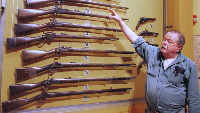 Robert Rockwell III shows off some of the antique guns from his extensive collection that are on display at the Rockwell Museum in Corning.