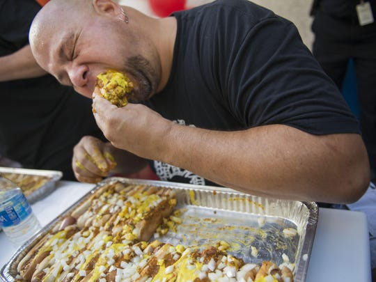 Matt Holowicki of Plymouth, now a four-time champion, participates in a coney dog eating contest on Thursday, Sept. 1 2016 at the American Coney Island.