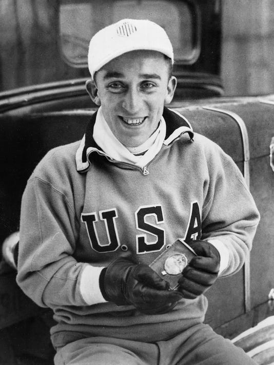 FILE - In this Feb. 8, 1932, file photo, Irving Jaffee of the United States shows his gold medal after winning the 10,000-meter speedskating championship at the third Winter Olympic Games at Lake Placid, N.Y.  Jaffee and Jack Shea, who became the country's first two-time winter gold medalists in 1932. (AP Photo/File)