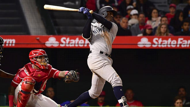 Yankees shortstop Didi Gregorius watches his solo home run off Los Angeles Angels relief pitcher Blake Parker in the tenth inning of the game at Angel Stadium of Anaheim.