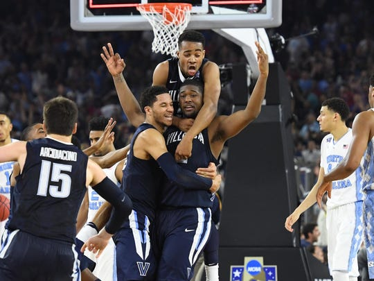 Kris Jenkins (2) celebrates his game-winning bucket