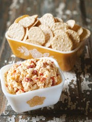 "Pimento cheese gets a kick with bourbon in ""The Southern Sympathy Cookbook."""