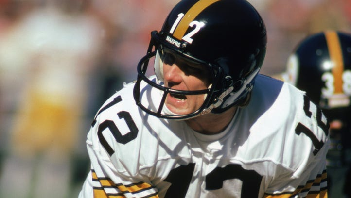 Quarterback Terry Bradshaw (12) of the Pittsburgh Steelers calls the play during the game against the Atlanta Falcons at Fulton County Stadium on November 1, 1981 in Atlanta.